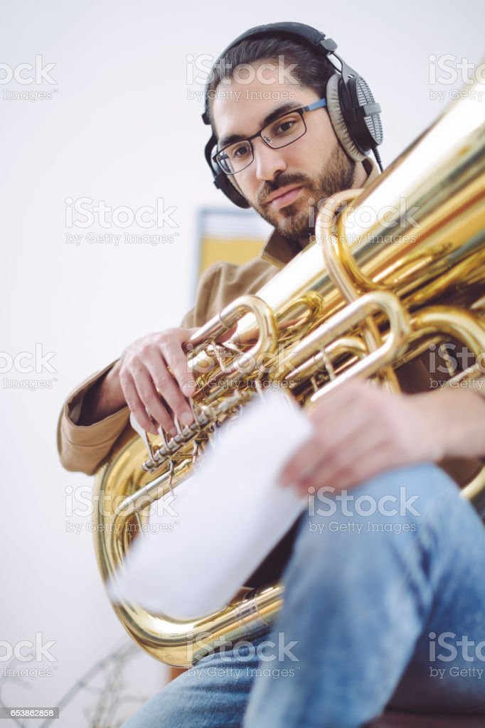 Young man composing music at home stock photo