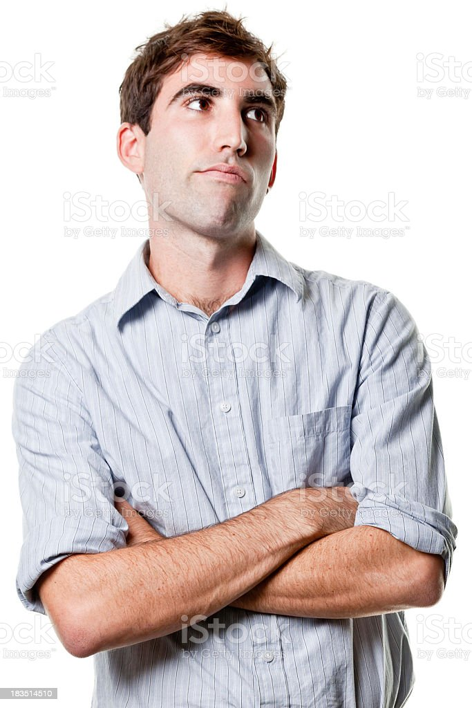 Young Man Crosses Arms and Looks Away stock photo