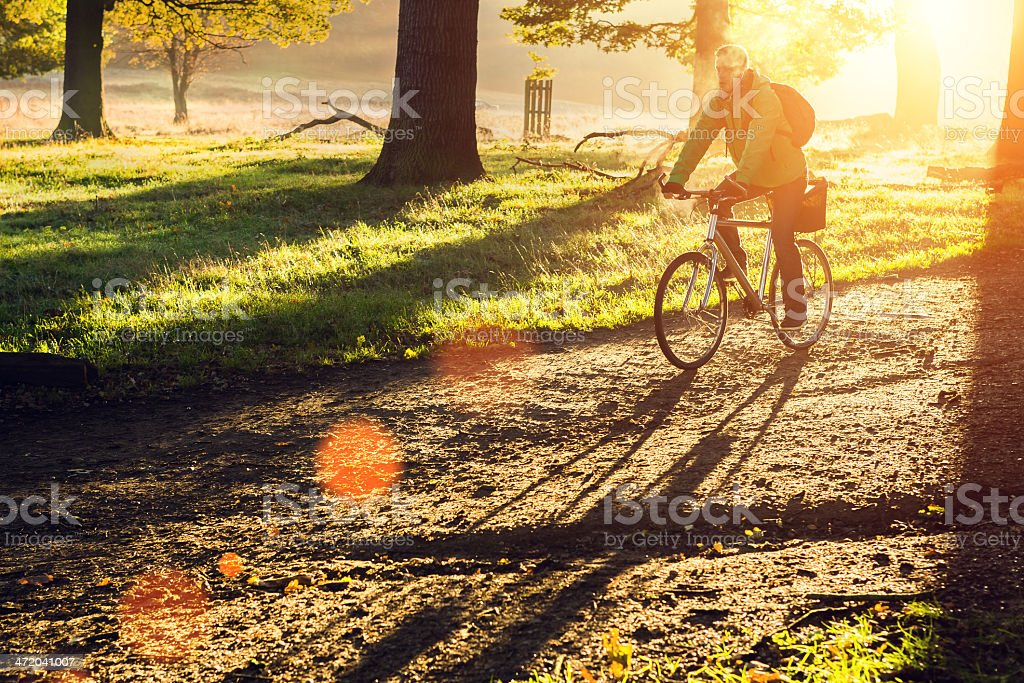 young man cycling in the morning stock photo