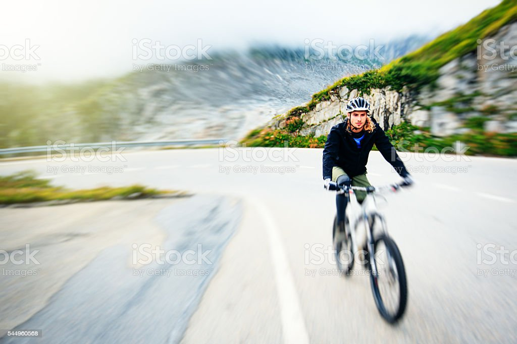 Young Man Cycling stock photo