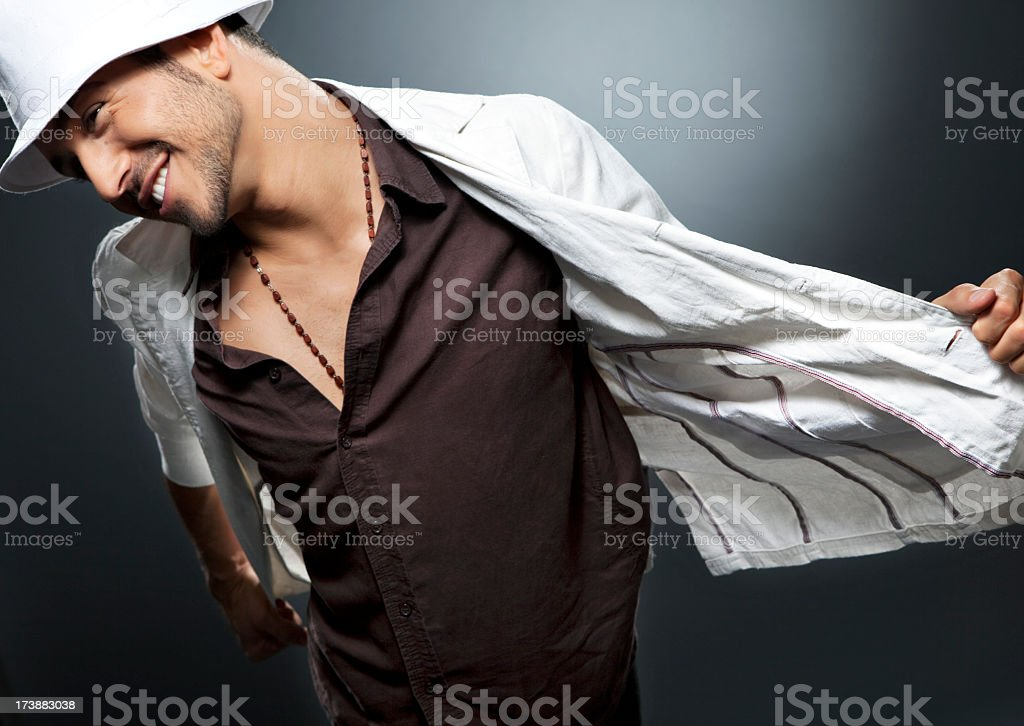 Young man dancing in stylish outfit and hat royalty-free stock photo