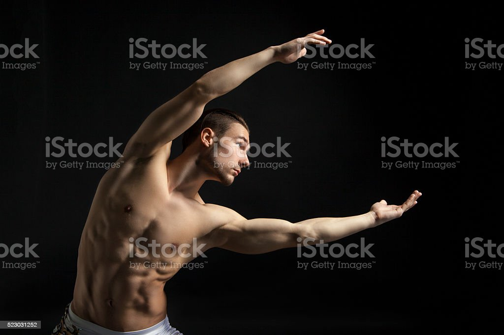 young man dancing over black stock photo