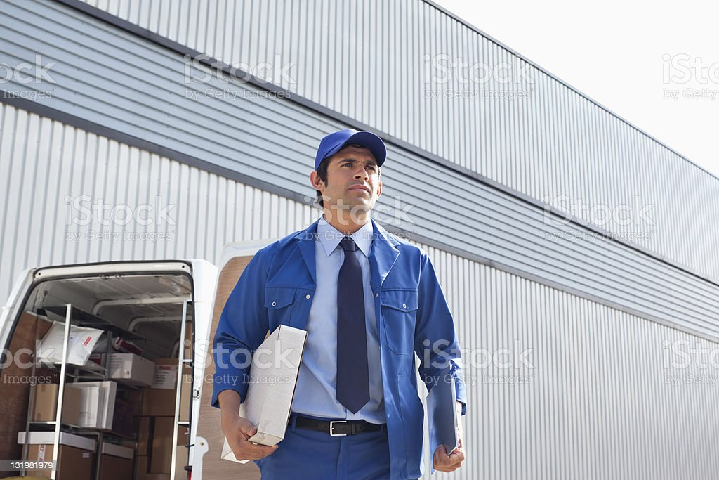 Young man delivering box stock photo