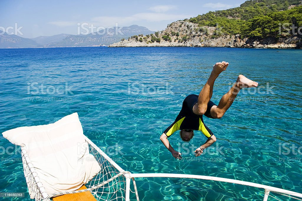Young Man Diving Into The Sea royalty-free stock photo