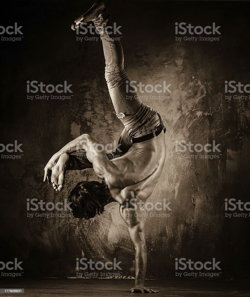 Young man  doing acrobatic movements royalty-free stock photo