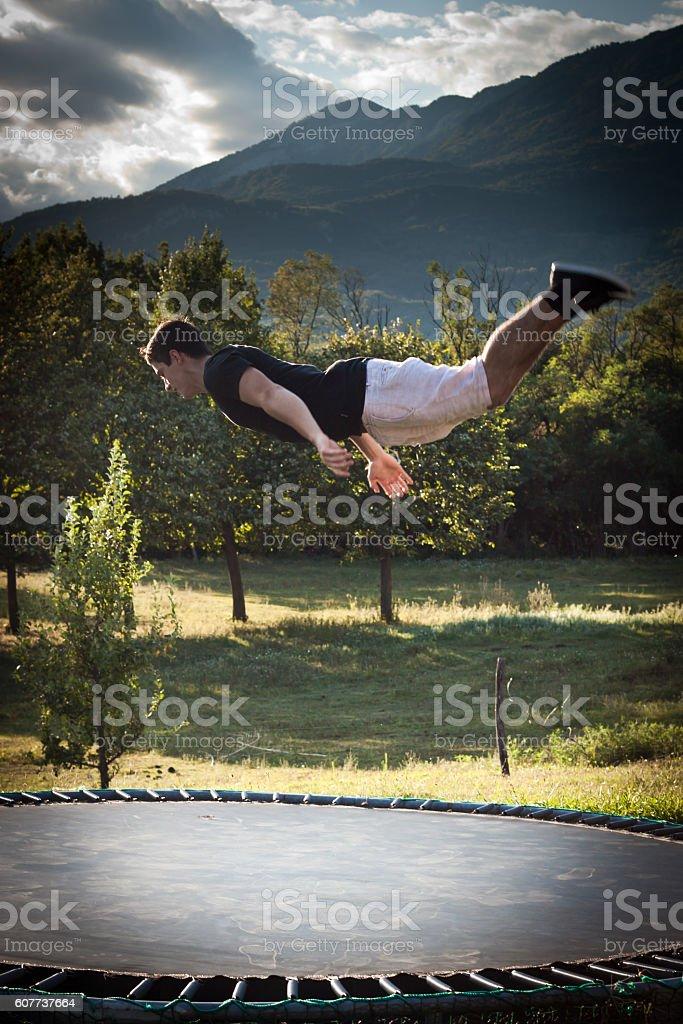 Young man doing backflip stock photo