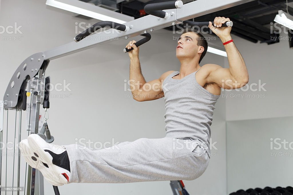 Young man doing exercise on high bar. royalty-free stock photo