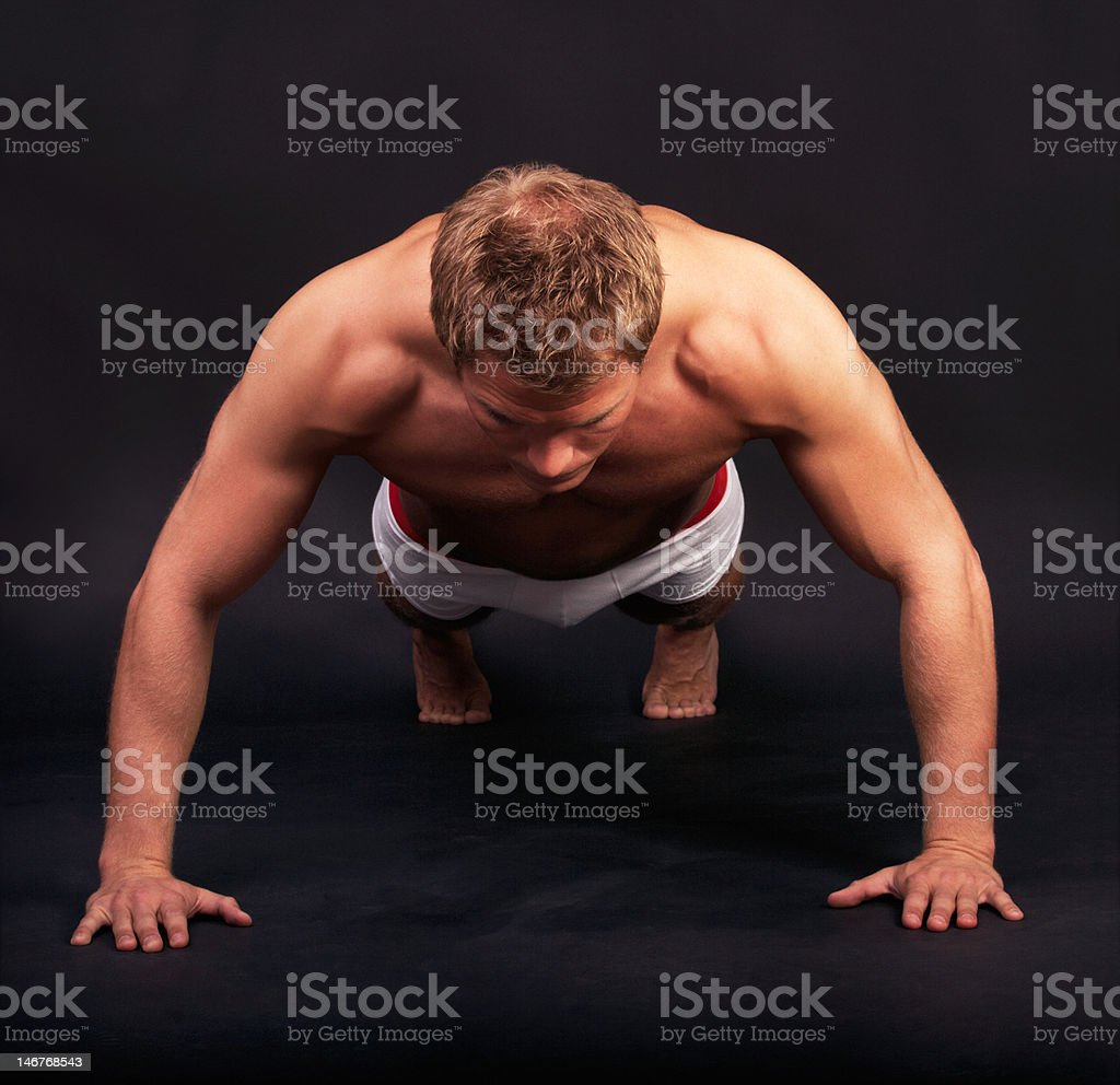Young man doing exercise royalty-free stock photo