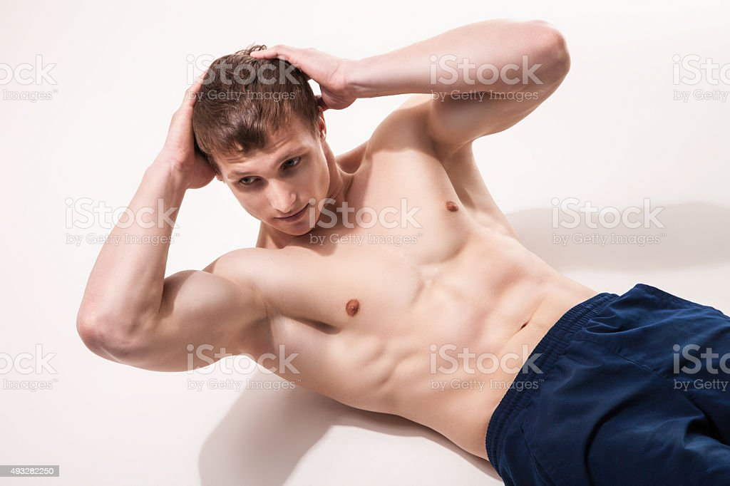 Young man doing exercises at studio stock photo