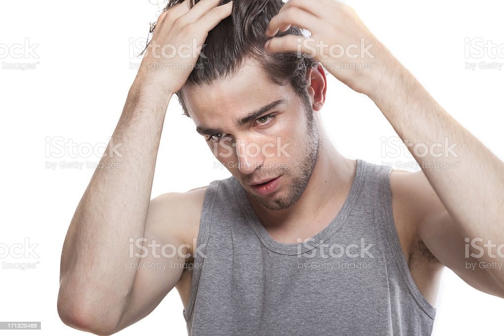 Young man doing his hair stock photo