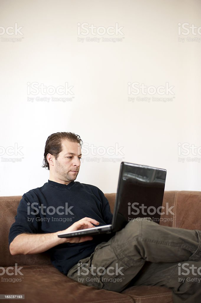 Young man doing 'home office' royalty-free stock photo