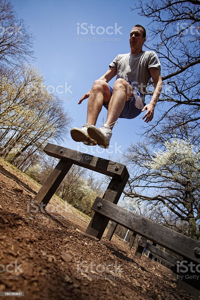 Young Man Doing Hurdle Exercise stock photo
