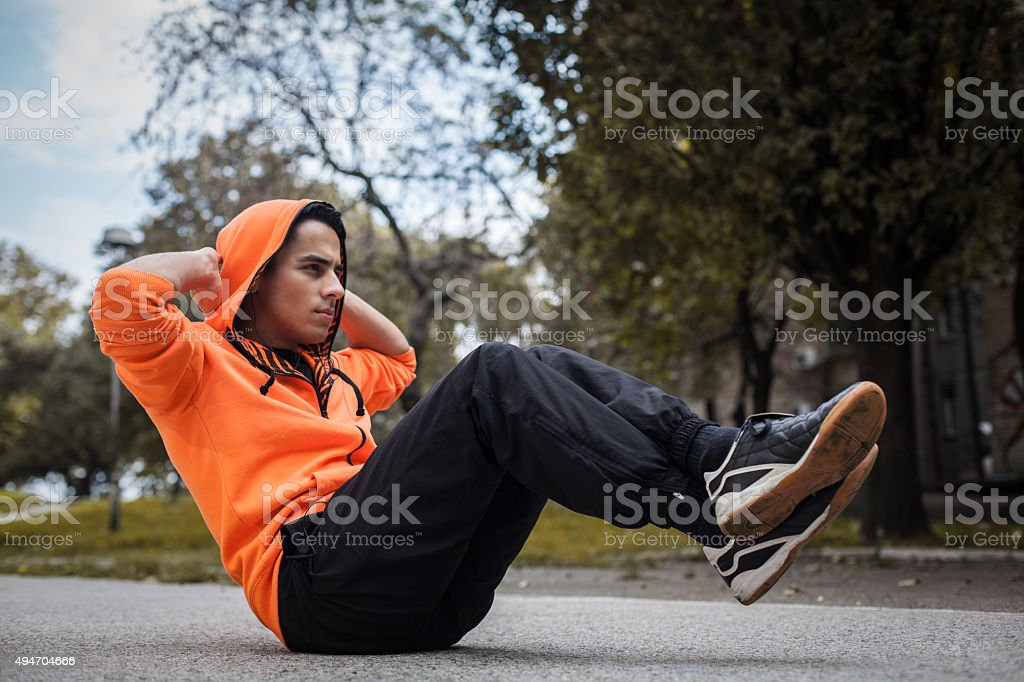 Young man doing situps stock photo