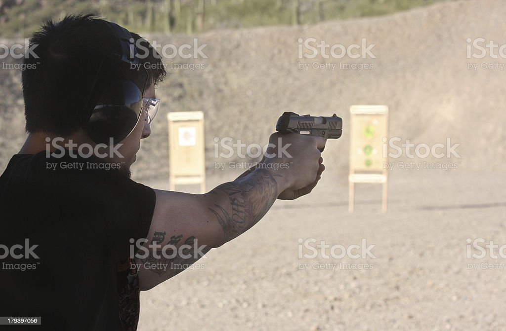 young man doing target pratice at range royalty-free stock photo