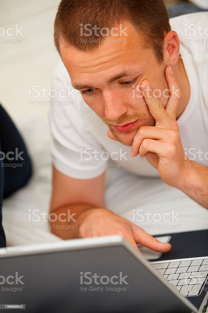 Young man doing work at home royalty-free stock photo