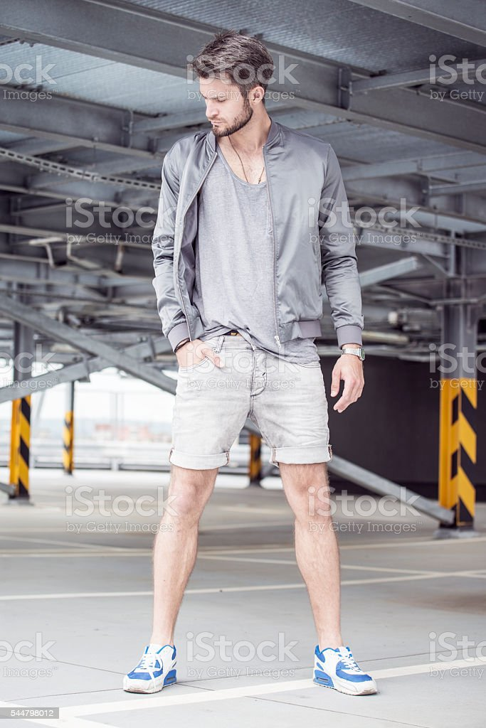 Young man dressed in sportswear stock photo