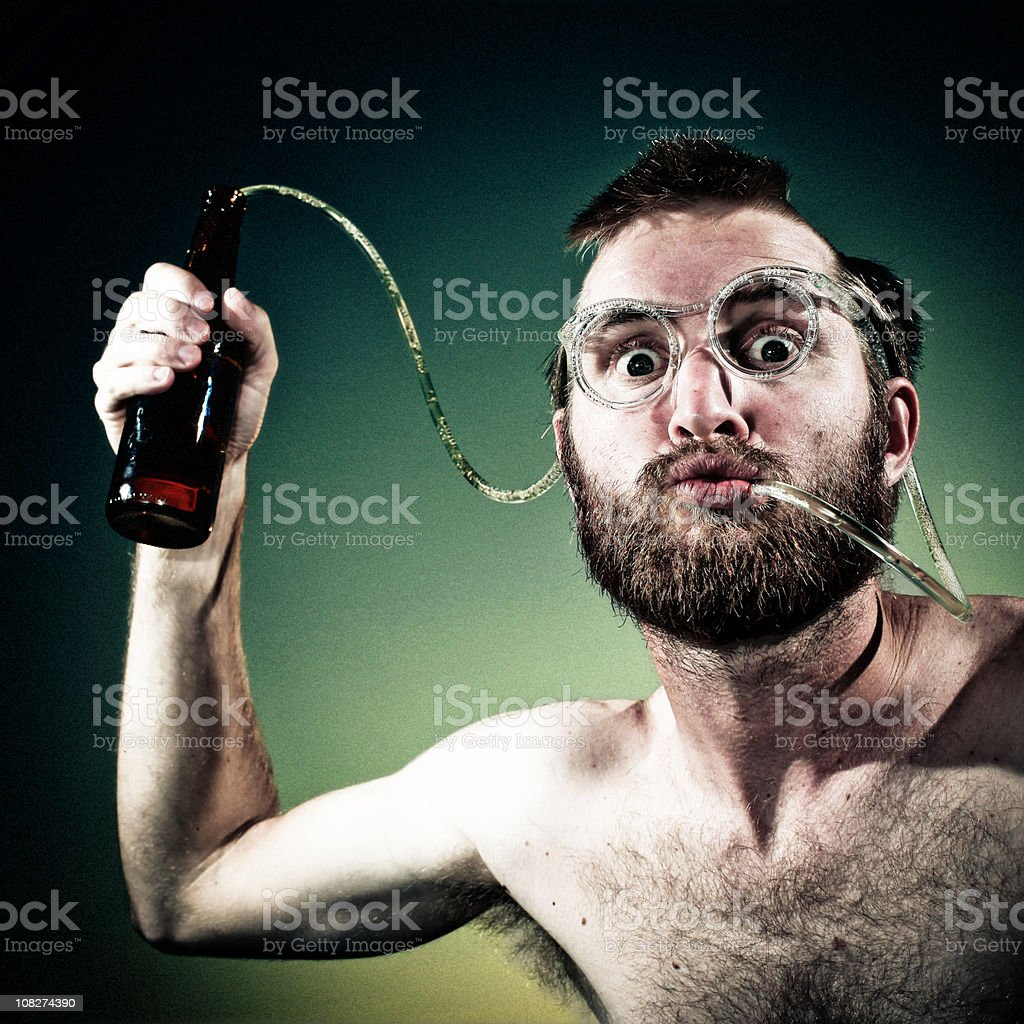 Young Man Drinking Beer Out of Crazy Straw Glasses royalty-free stock photo