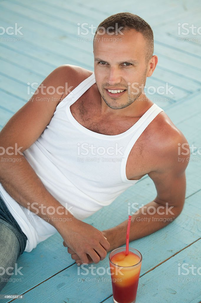 young man drinking cocktail stock photo