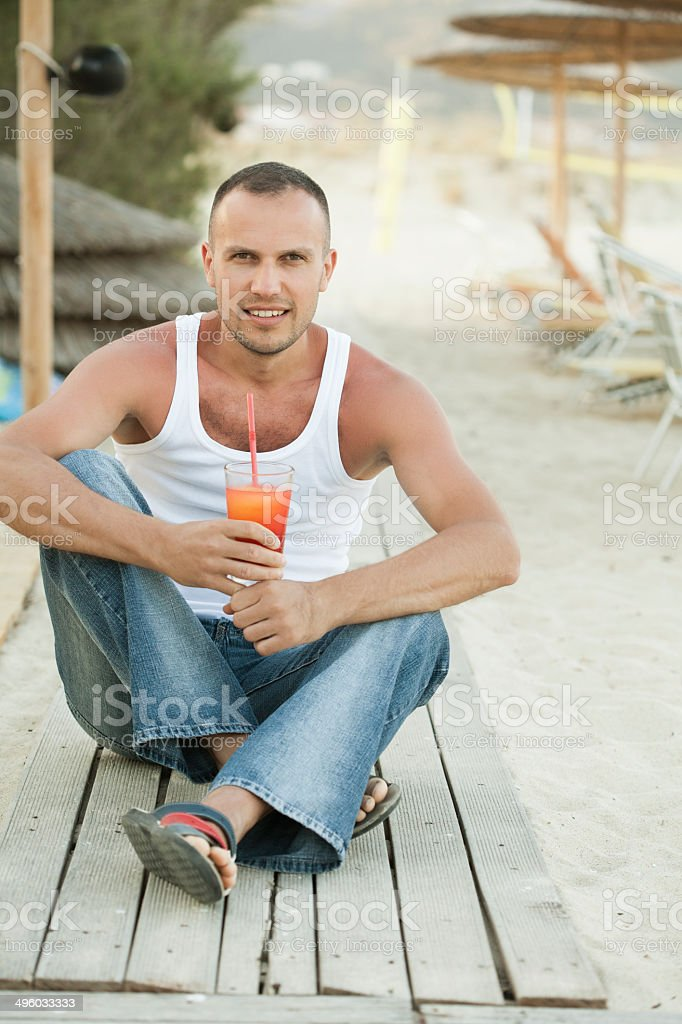 young man drinking cocktail royalty-free stock photo