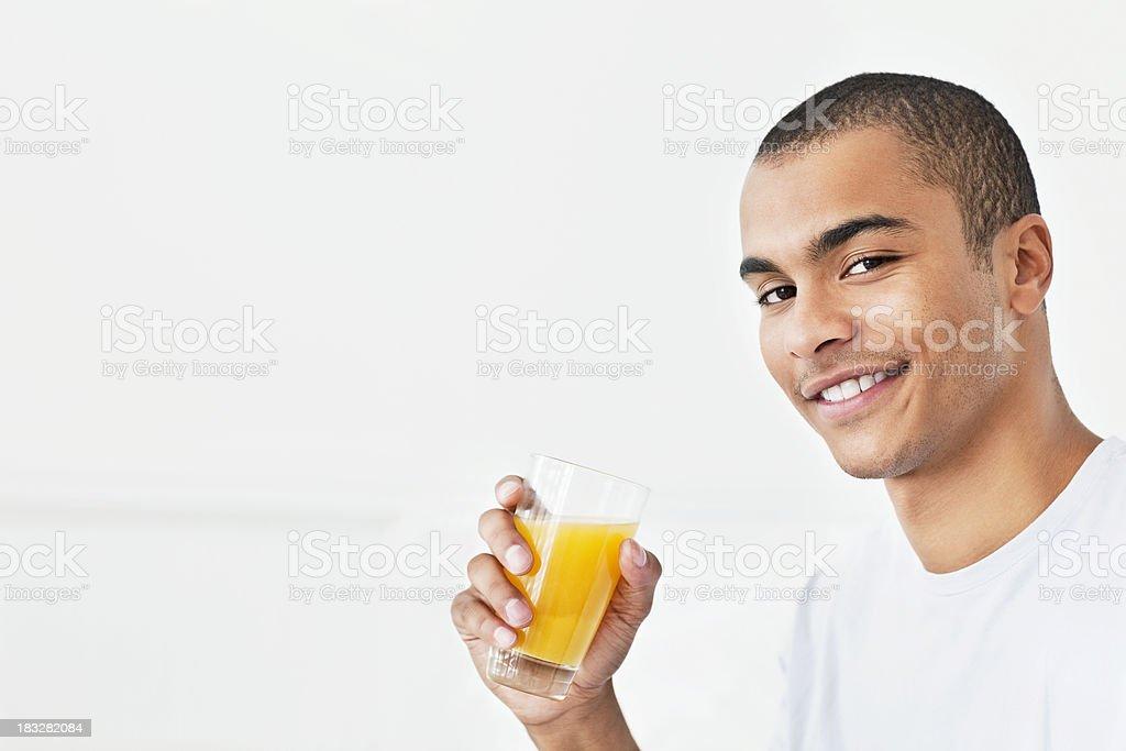 Young Man Drinking Orange Juice royalty-free stock photo