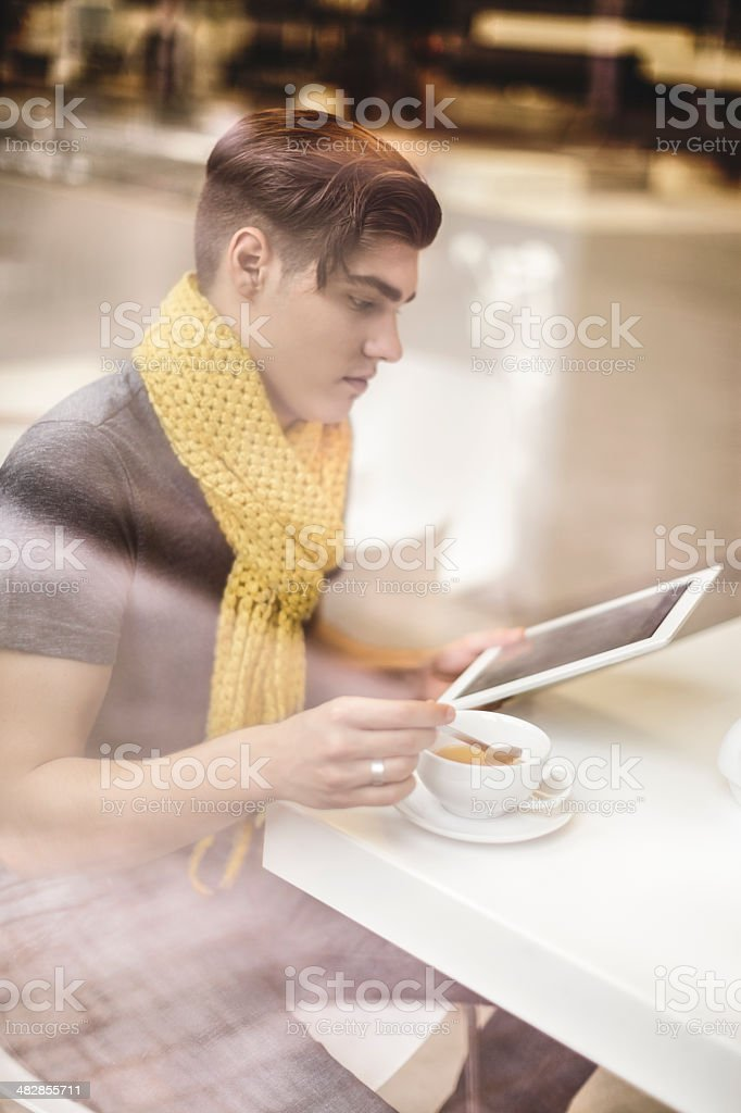 Young man drinking tea royalty-free stock photo