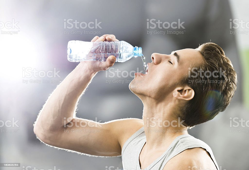 Young man drinking water. royalty-free stock photo