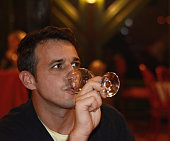 Young man drinking Wine.
