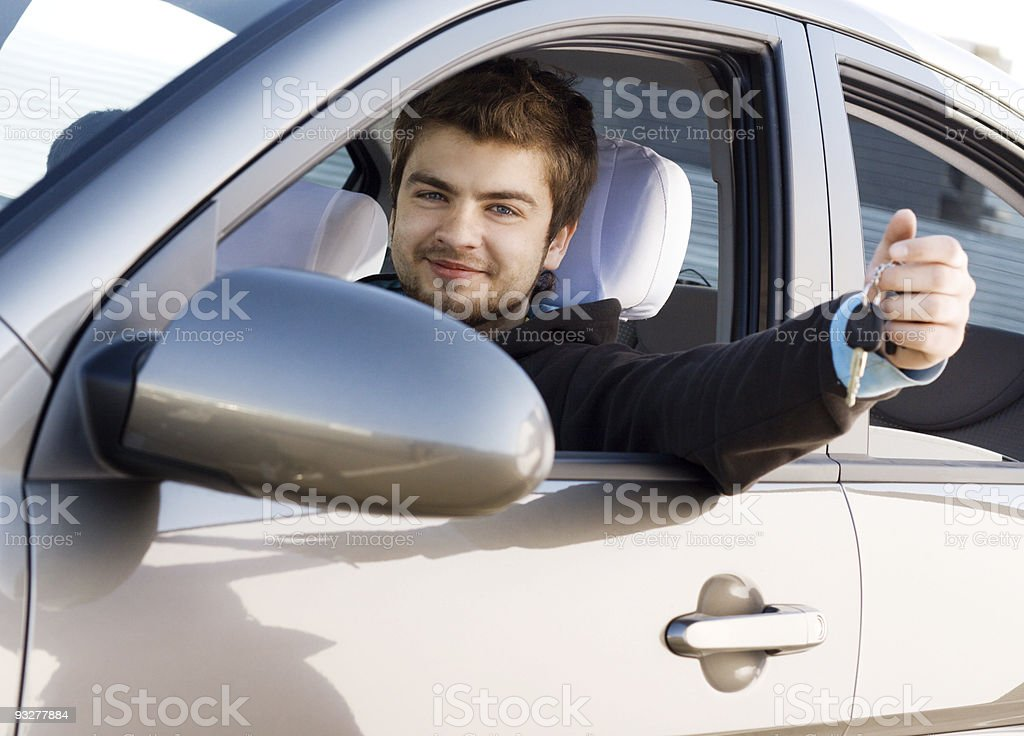 Young man driving a car royalty-free stock photo