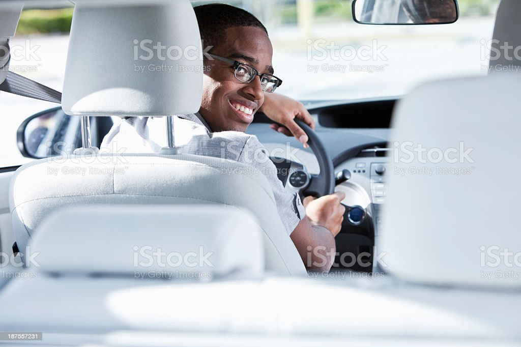 Young man driving car stock photo