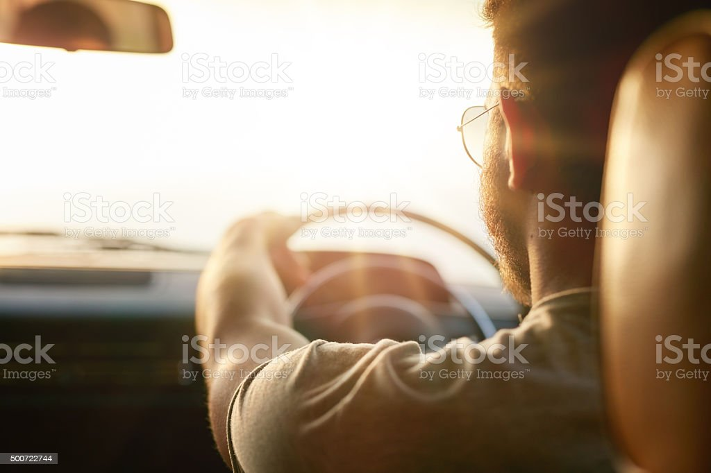 Young man driving his car stock photo