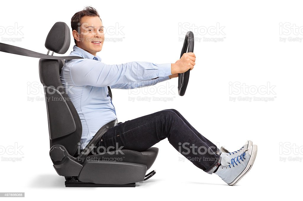 Young man driving seated on car seat stock photo