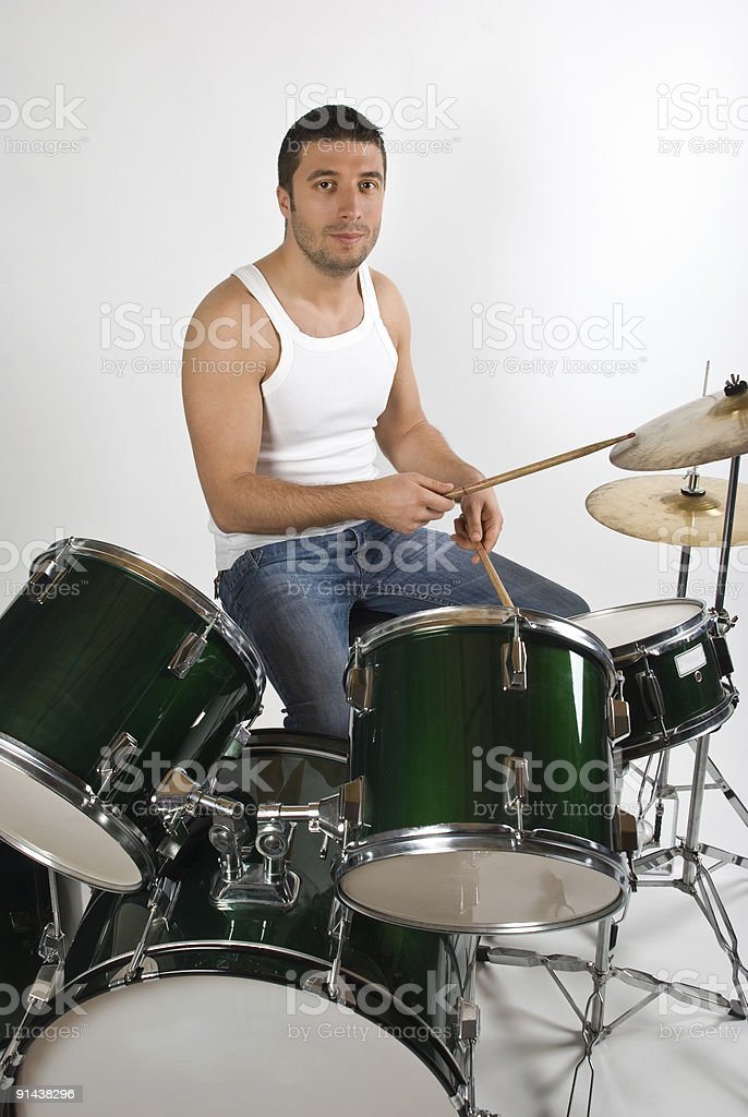 Young man drummer stock photo