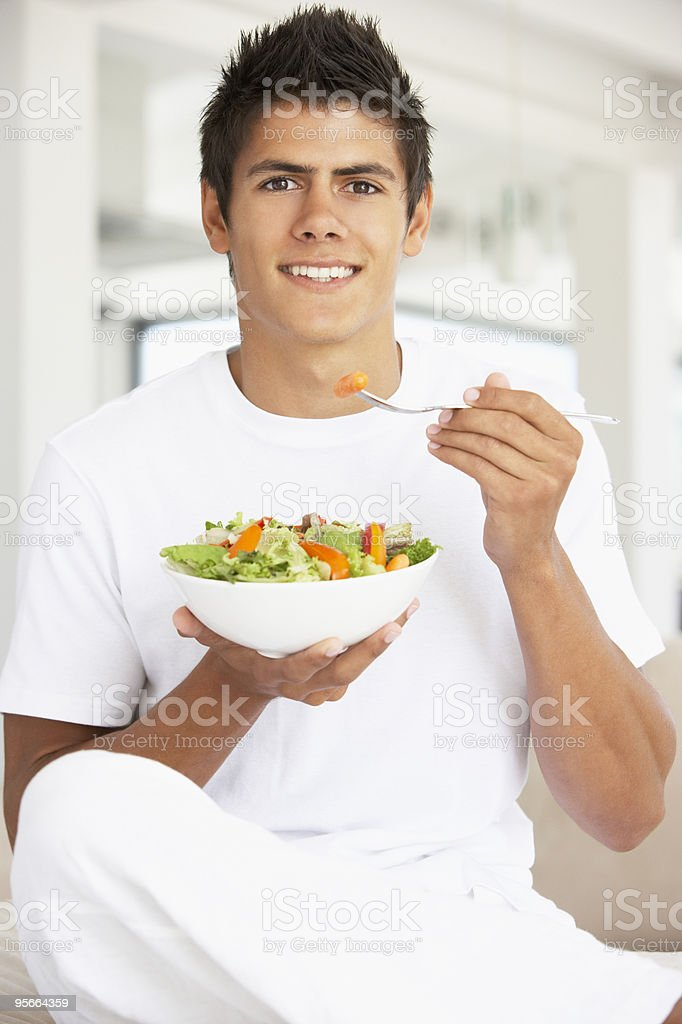 Young Man Eating A Salad royalty-free stock photo
