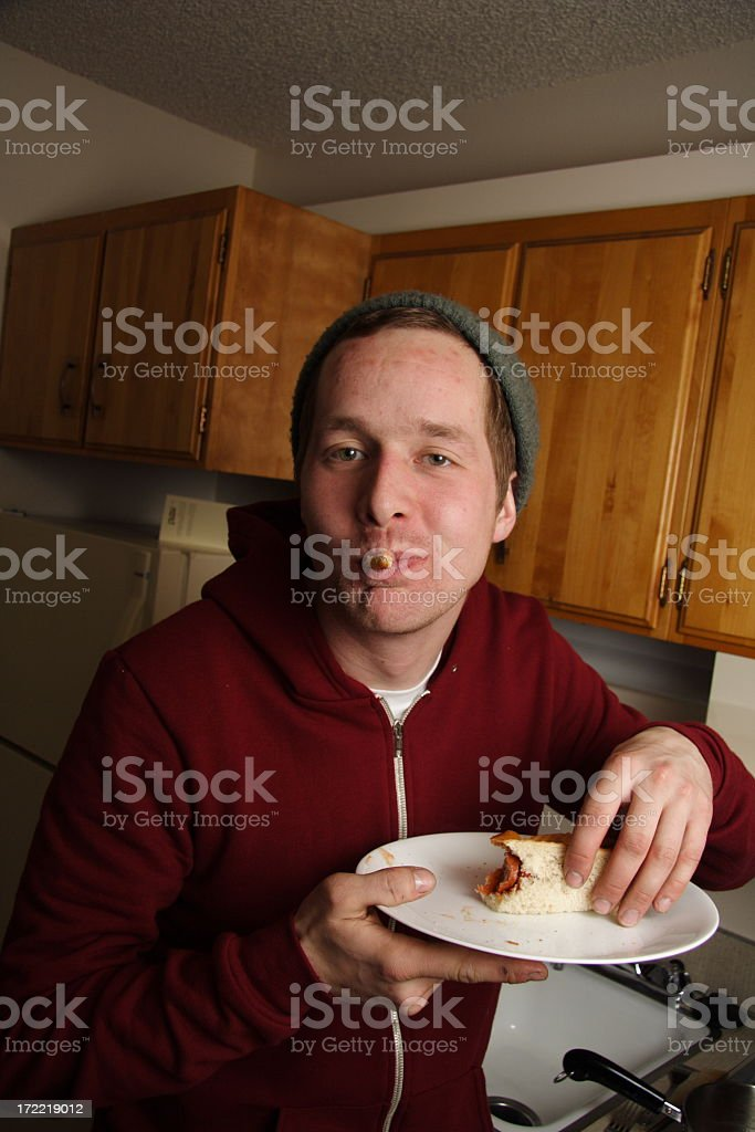 young man eating stock photo