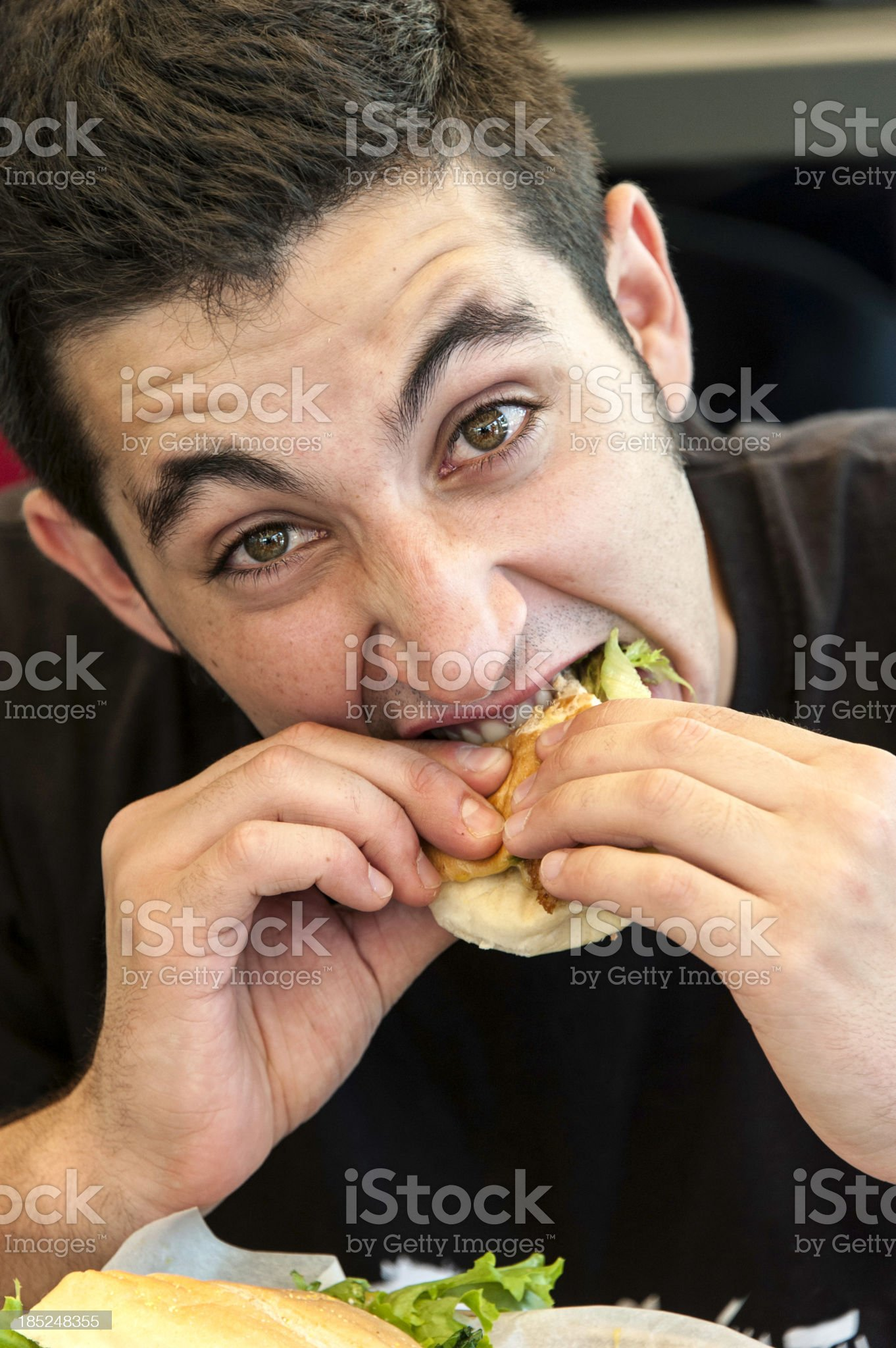 Young man eating royalty-free stock photo