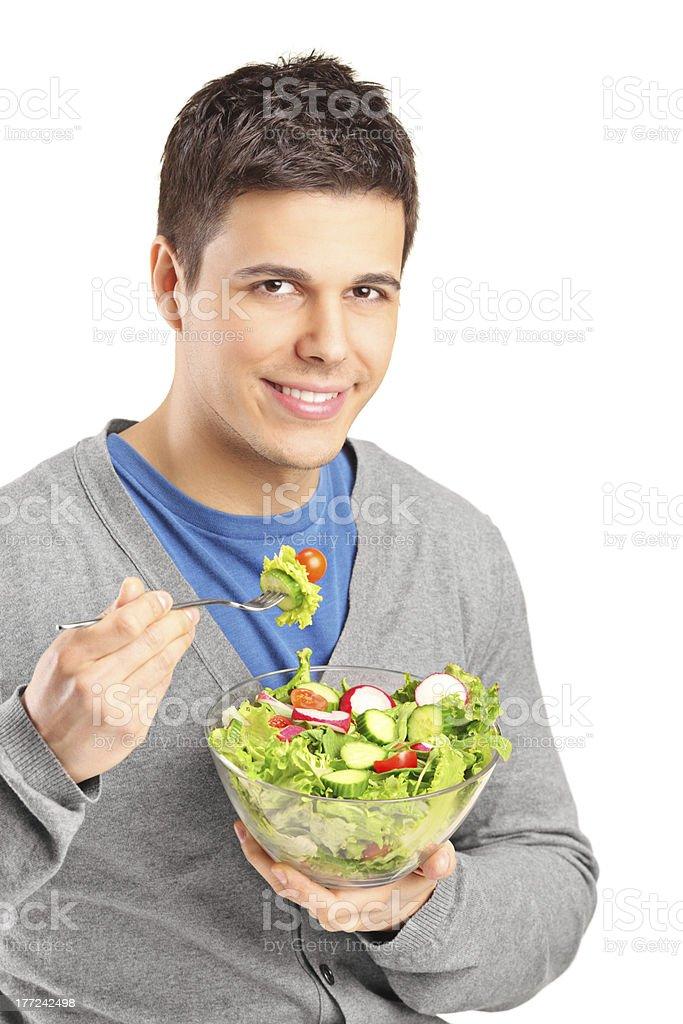 Young man eating salad royalty-free stock photo