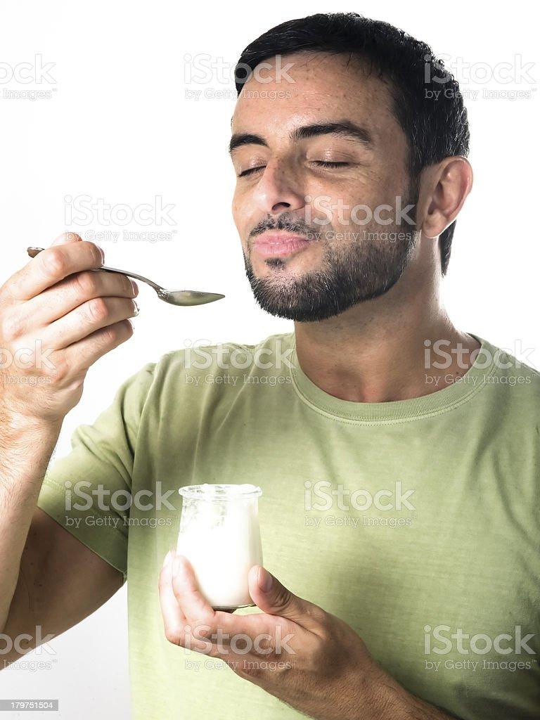 Young Man Eating Yogurt royalty-free stock photo