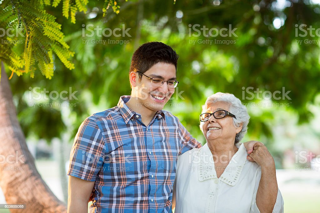 Young man embracing grandmother and smiling stock photo