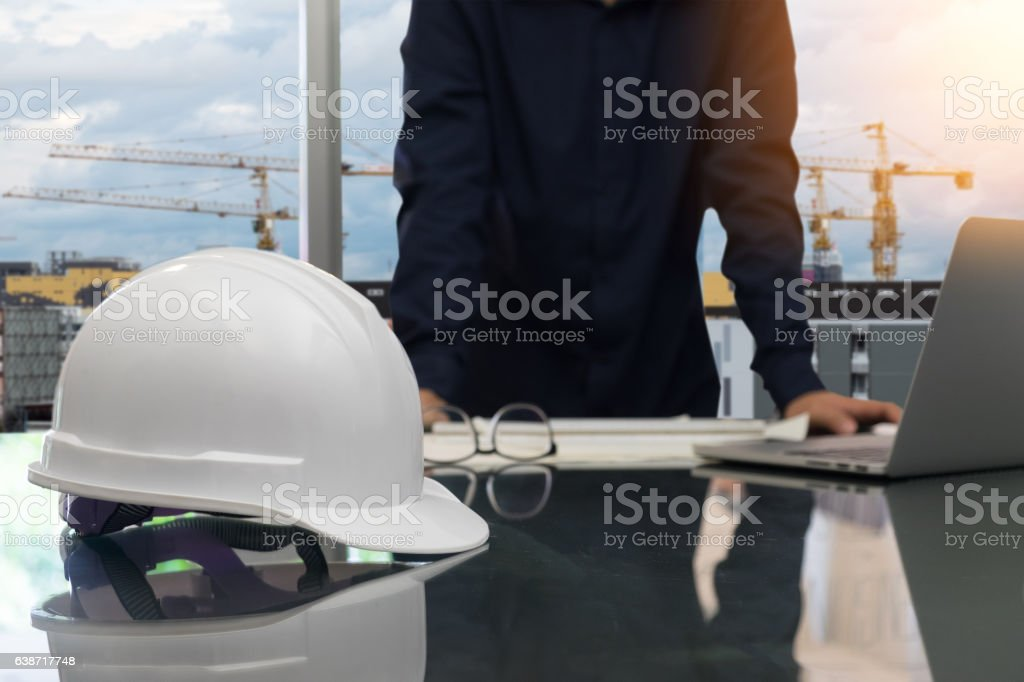 Young man engineer working on his plane project at site stock photo