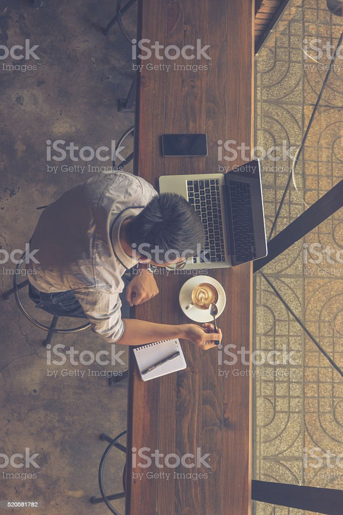 Young man enjoy a cup of coffee in the morning stock photo