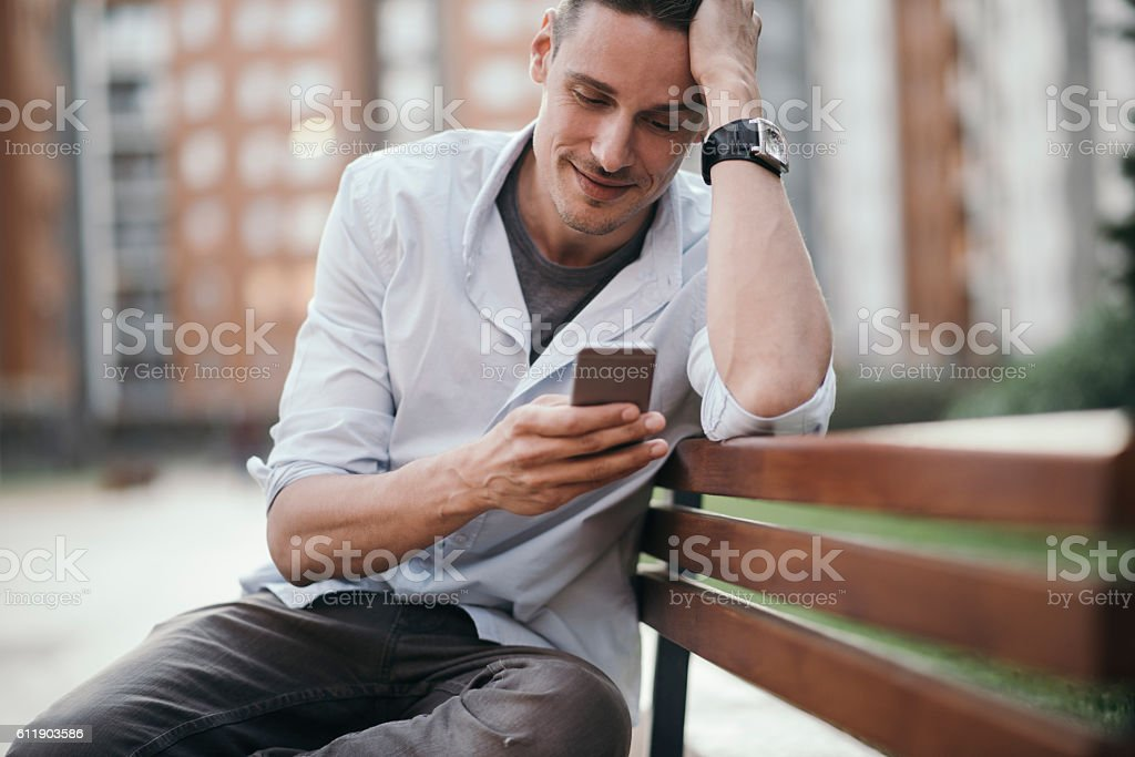 Young man enjoying a casual afternoon in park stock photo