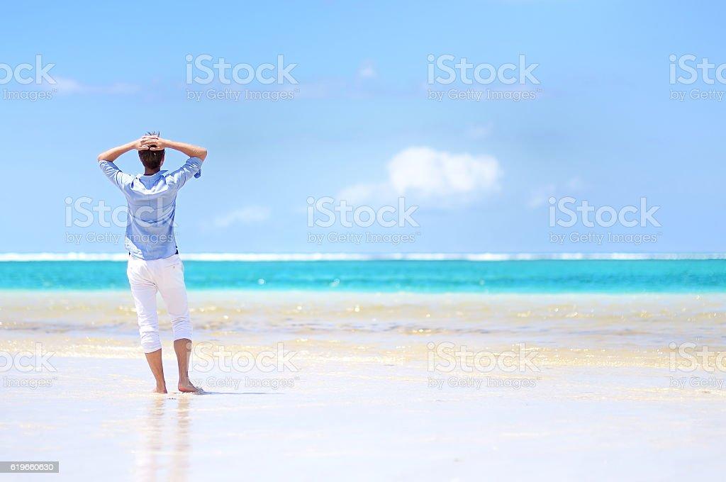 Young man enjoying a sea view stock photo