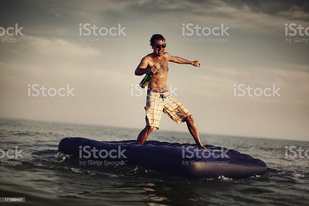 Young Man Enjoying Beach Party royalty-free stock photo