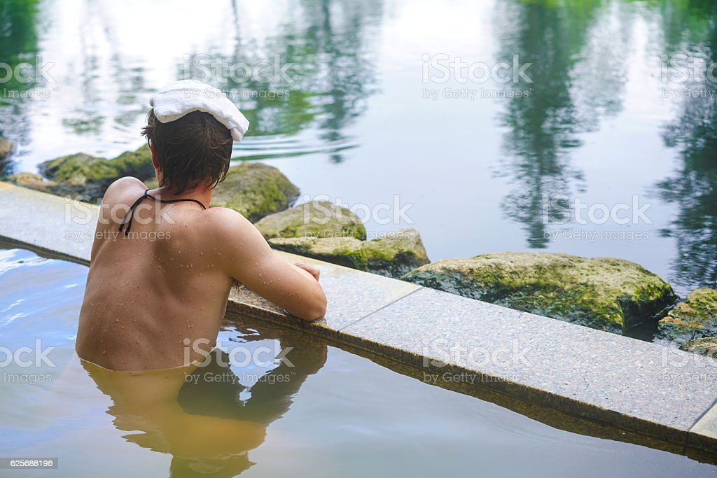Young man enjoying hot spring water on Hokkaido, Japan stock photo
