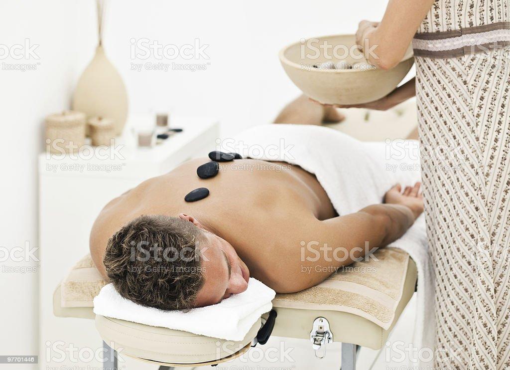 Young man enjoying spa treatment royalty-free stock photo