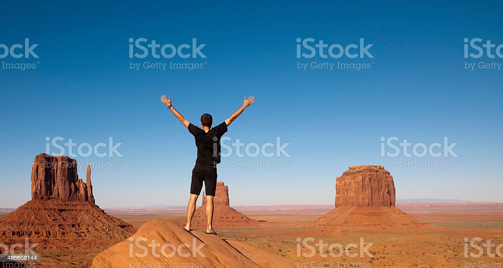 Young man enjoying view of Monument Valley stock photo