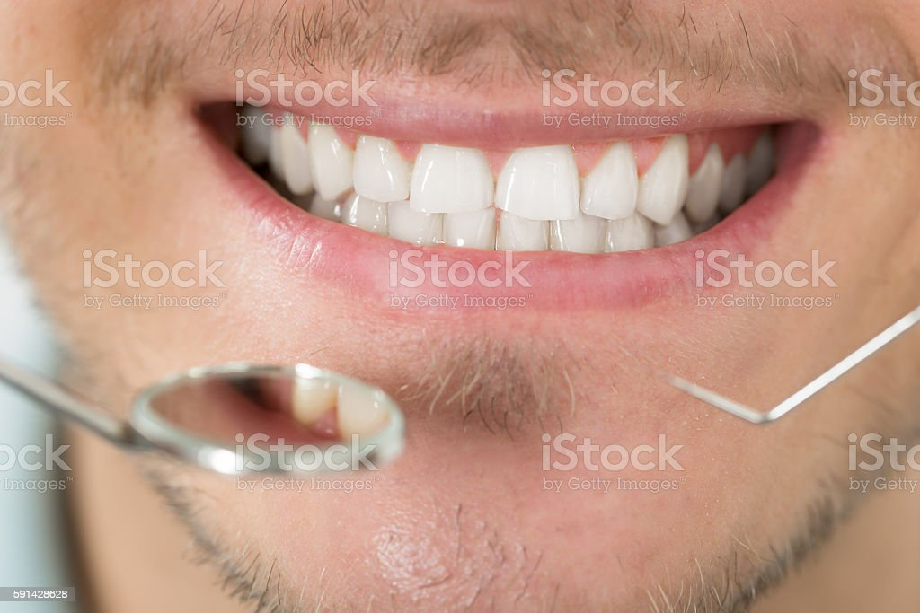 Young Man Examining Her Teeth stock photo