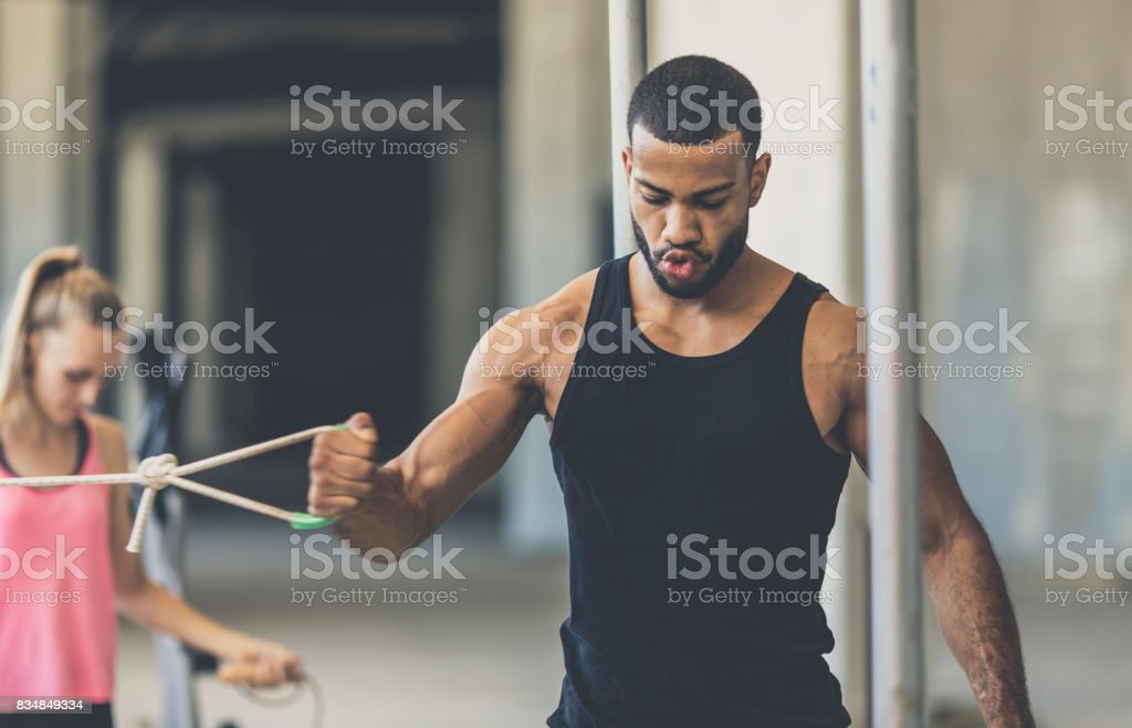 Young man exercising in an urban gym stock photo