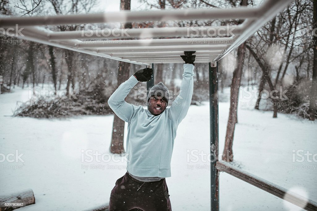 Young man exercising in the forest stock photo