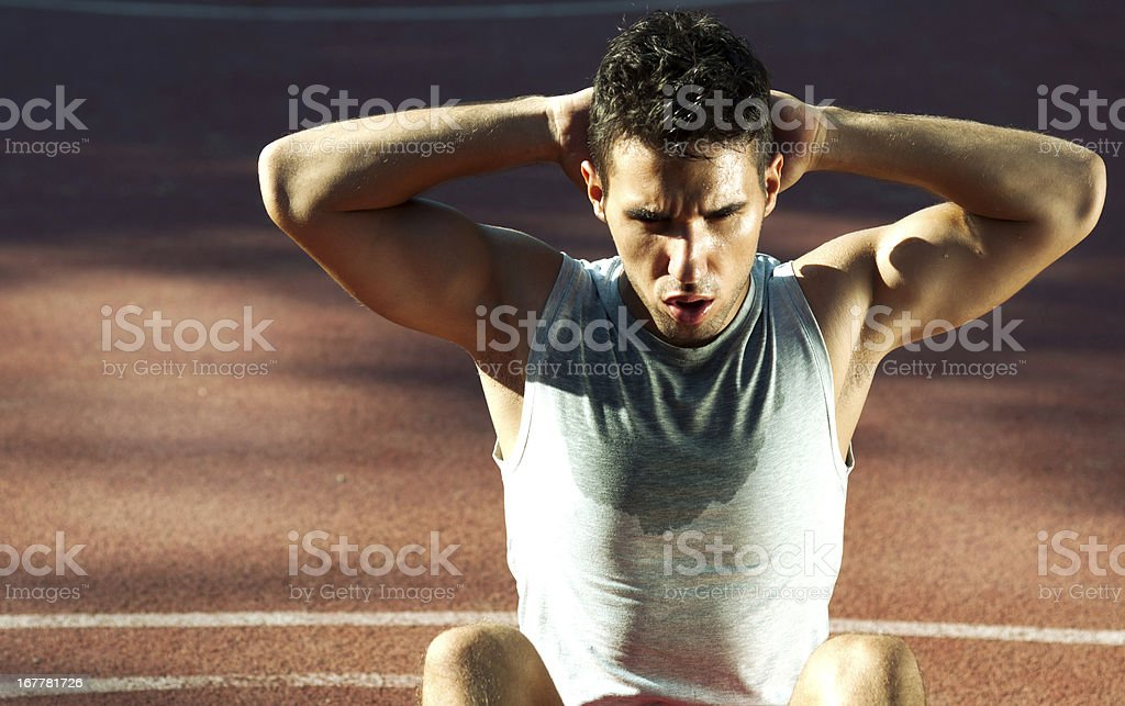 young man exercising outdoors stock photo